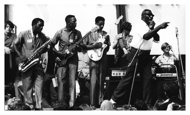 Howlin' Wolf with his band at the Newport Festival in 1966