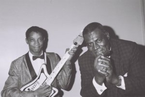 Howlin' Wolf with a young Hubert Sumlin.  Despite their occasional fighting, they maintained a father-son like relationship throughout Wolf's life.